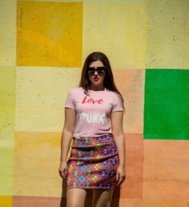 Pink t-shirt with a logo print 'Love is Punk'.